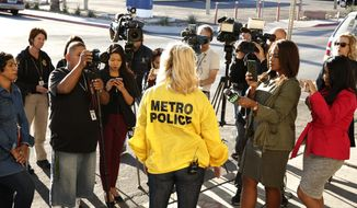 Police Capt. Kelly McMahill briefs the media on an officer-involved shooting at University Medical Center on Monday, Sept. 25, 2017, in Las Vegas. Authorities said a man in police custody inside the hospital was fatally shot by an officer while the man was pointing a stun gun. (Bizuayehu Tesfaye/Las Vegas Review-Journal via AP)