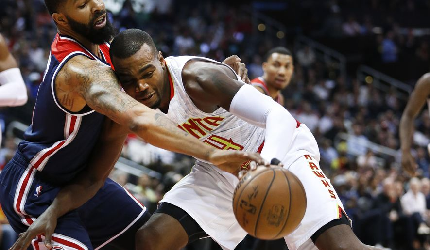 File-This April 24, 2017, file photo shows Atlanta Hawks forward Paul Millsap (4) working against Washington Wizards forward Markieff Morris (5) in the first half in Game 4 of a first-round NBA basketball playoff series  in Atlanta. Washington Wizards coach Scott Brooks figures he has several options for replacing Morris while the starting power forward misses the beginning of the NBA season after having surgery for a sports hernia. (AP Photo/John Bazemore, File)