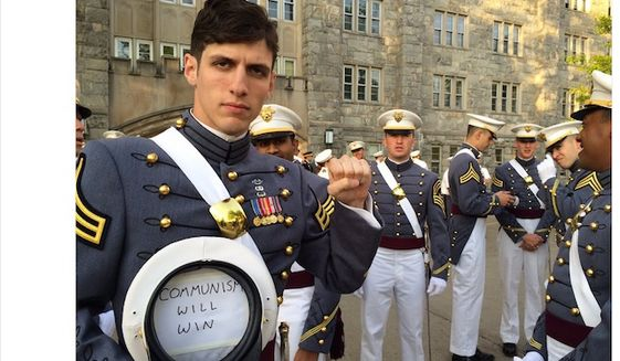 "West Point alumnus and Infantry Officer Spenser Rapone presents a ""communism will win"" sign while in uniform. (Image: Twitter, Commie Bebop)"