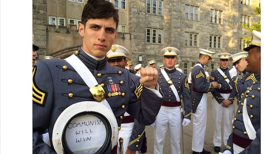 "West Point alumnus and Infantry Officer Spenser Rapone presents a ""communism will win"" sign while in uniform. (Image: Twitter, Commie Bebop) ** FILE **"