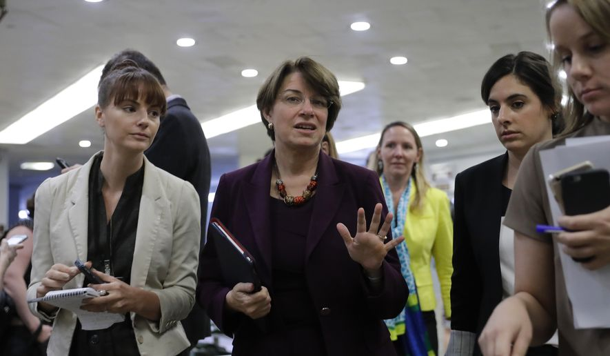 Sen. Amy Klobuchar, D-Minn., arrives at the Capitol in Washington, Tuesday, Sept. 26, 2017, as Senate Majority Leader Mitch McConnell, R-Ky., decided to pull the Graham-Cassidy bill, the GOP's latest attempt to repeal the Obama health care law. (AP Photo/J. Scott Applewhite) ** FILE **