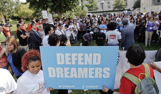 Immigrant rights supporters gather at the U.S. Capitol in Washington, Tuesday, Sept. 26, 2017. The groups and allies are demanding that Congress pass a 'Clean Dream Act' that will prevent the deportation of Dreamers working and studying in the U.S., and reform legalization of those with Temporary Protection Status who came to the U.S. fleeing natural disasters or civil wars. (AP Photo/Pablo Martinez Monsivais)