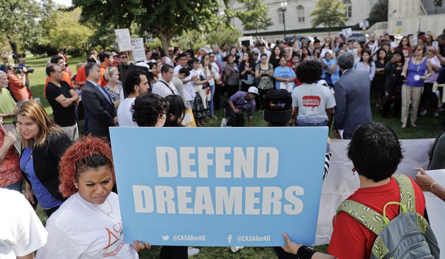 Immigrant rights supporters gather at the U.S. Capitol in Washington, Tuesday, Sept. 26, 2017. The groups and allies are demanding that Congress pass a 'Clean Dream Act' that will prevent the deportation of Dreamers working and studying in the U.S., and reform legalization of those with Temporary Protection Status who came to the U.S. fleeing natural disasters or civil wars. (AP Photo/Pablo Martinez Monsivais) **FILE**