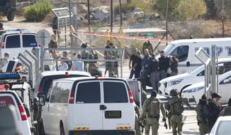 Israeli security deploys at an entrance to Har Adar settlement near Jerusalem, Tuesday, Sept. 26, 2017. Israeli police said that a Palestinian attacker opened fire at the entrance to the settlement killing three Israeli men and critically wounding a fourth. (AP Photo/Mahmoud Illean) ** FILE **