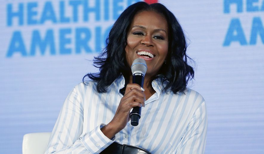 In this May 12, 2017, file photo, former first lady Michelle Obama smiles while speaking at the Partnership for a Healthier American 2017 Healthier Future Summit in Washington. (AP Photo/Pablo Martinez Monsivais, File)