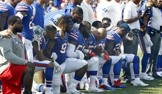 In this Sunday, Sept. 24, 2017, file photo, Buffalo Bills players take a knee during the playing of the national anthem prior to an NFL football game against the Denver Broncos in Orchard Park, N.Y. What began more than a year ago with a lone NFL quarterback protesting police brutality against minorities by kneeling silently during the national anthem before games has grown into a roar with hundreds of players sitting, kneeling, locking arms or remaining in locker rooms, their reasons for demonstrating as varied as their methods. (AP Photo/Jeffrey T. Barnes, File)