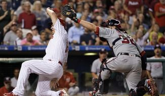 Philadelphia Phillies' Tommy Joseph, left, scores past the tag from Washington Nationals catcher Matt Wieters on a two-run double by Cameron Rupp during the third inning of a baseball game, Tuesday, Sept. 26, 2017, in Philadelphia. (AP Photo/Matt Slocum)