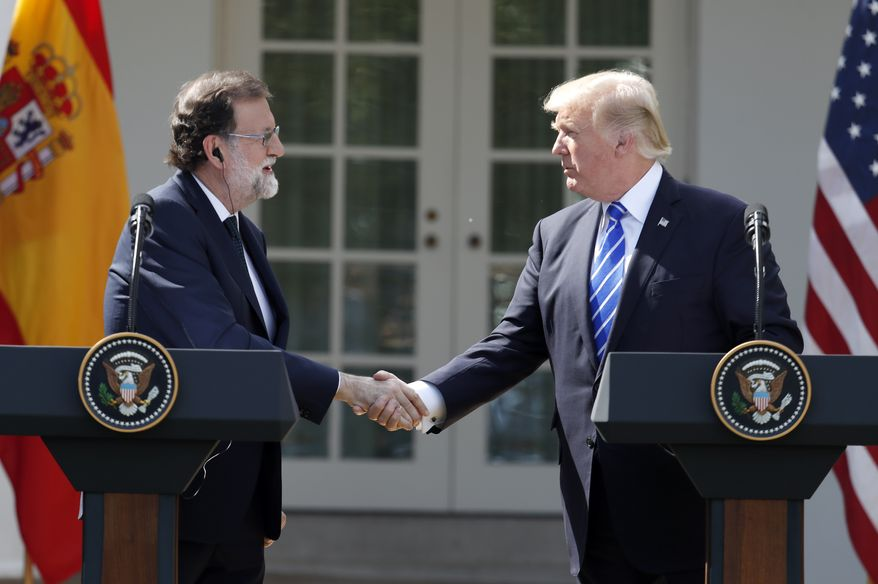 President Donald Trump shakes hands during a news conference with Spanish Prime Minister Mariano Rajoy in the Rose Garden of the White House, Tuesday, Sept. 26, 2017, in Washington. (AP Photo/Alex Brandon)