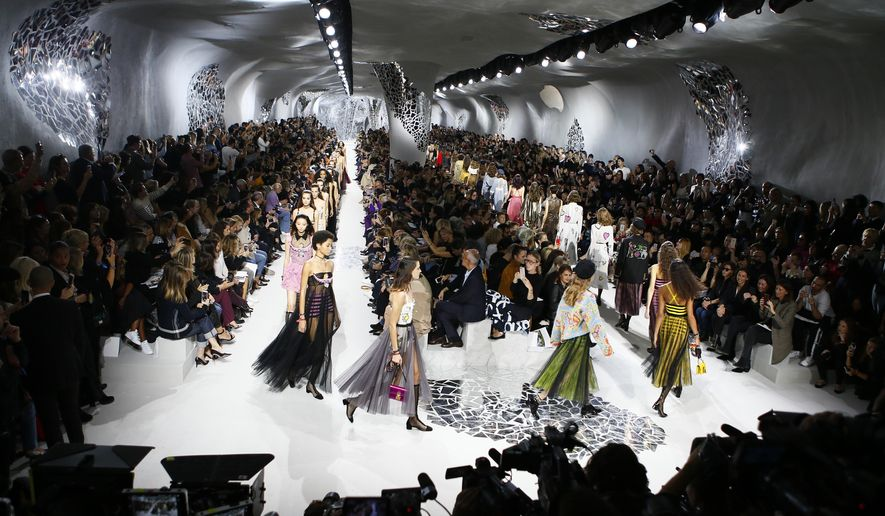 Models wear creations for Christian Dior Spring/Summer 2018 ready-to-wear fashion collection presented in Paris, Tuesday, Sept.26, 2017. (AP Photo/Francois Mori)