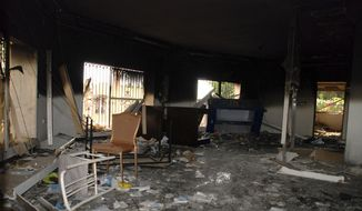 This Sept. 12, 2012, file photo shows glass, debris and overturned furniture are strewn inside a room in the gutted U.S. Consulate in Benghazi, Libya, after an attack that killed four Americans, including Ambassador Chris Stevens. (AP Photo/Ibrahim Alaguri, File)