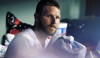 Boston Red Sox's Chris Sale sits in the dug out after giving up three runs to the Toronto Blue Jays during the fifth inning of a baseball game in Boston, Tuesday, Sept. 26, 2017. (AP Photo/Michael Dwyer)