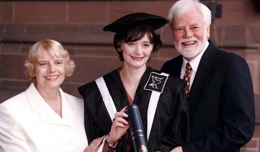"FILE - In this July 15, 1997 file photo, Cherie Booth with her parents Gale and Tony Booth after receiving an honorary fellowship from John Moore's University in Liverpool, England. British actor Tony Booth, father-in-law of former Prime Minister Tony Blair, has died aged 85. Booth's family says he died late Monday, Sept. 25, 2017 after suffering from Alzheimer's disease and heart problems. Booth had his most enduring role as the left-wing son-in-law of a bigoted father in the sitcom ""Till Death Us Do Part."" The show ran for almost a decade from 1966 and inspired the American series ""All in the Family."" (Peter Wilcock/PA via AP, file)"