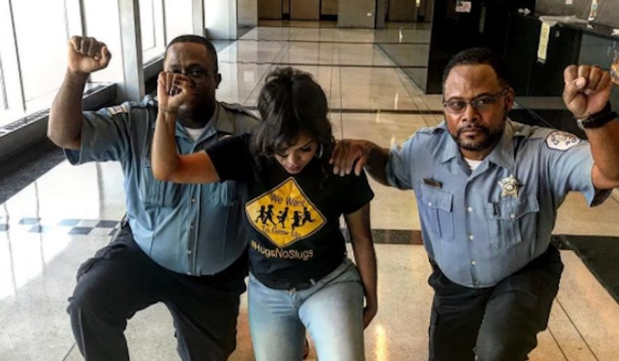 Two Chicago police officers will be reprimanded for kneeling and raising clenched fists in a show of solidarity with Colin Kaepernick. (Instagram/@englewoodbarbie)