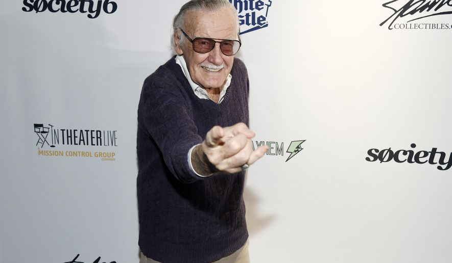 """FILE - In this Aug. 22, 2017, file photo, comic book writer Stan Lee strikes a """"Spider-Man"""" pose at the """"Extraordinary: Stan Lee"""" tribute event at the Saban Theatre in Beverly Hills, Calif. Lee is raising money for victims of Hurricane Irma while in Florida for the MegaCon Tampa Bay convention in Tampa on Friday, Sept. 29, 2017. Lee says he feels everyone should do their part to help victims of the storm, and he is auctioning off a one-on-one meal, as well as artwork from his personal collection, during his panel at the convention on Friday. (Photo by Chris Pizzello/Invision/AP, File)"""