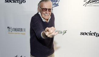 "FILE - In this Aug. 22, 2017, file photo, comic book writer Stan Lee strikes a ""Spider-Man"" pose at the ""Extraordinary: Stan Lee"" tribute event at the Saban Theatre in Beverly Hills, Calif. Lee is raising money for victims of Hurricane Irma while in Florida for the MegaCon Tampa Bay convention in Tampa on Friday, Sept. 29, 2017. Lee says he feels everyone should do their part to help victims of the storm, and he is auctioning off a one-on-one meal, as well as artwork from his personal collection, during his panel at the convention on Friday. (Photo by Chris Pizzello/Invision/AP, File)"