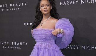 FILE - In this Sept. 19, 2017 file photo, singer Rihanna poses for photographers upon arrival at the Fenty Beauty by Rihanna fashion range launch during London Fashion Week in London. (Photo by Vianney Le Caer/Invision/AP, File)