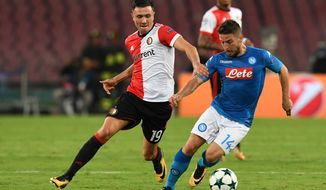 Napoli's Dries Mertens, right, and Feyenoord's Steven Berghuis vie for the ball during the Uefa Champions League, Group F soccer match between Napoli and Feyenoord at the San Paolo stadium in Naples, Italy, Tuesday, Sept. 26, 2017. (Ciro Fusco/ANSA via AP)