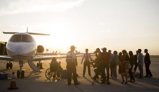 People arrive in West Palm Beach, Fla., from Puerto Rico on Tuesday, Sep. 26, 2017. The Eagles Wings Foundation led a mission that transported elderly nursing home patients and some family members to safety after Hurricane Maria struck Puerto Rico. With power out across nearly the entire island, families were anxious in particular to get out elderly and other vulnerable relatives amid concerns about access to food and fresh water. (Calla Kessler/Palm Beach Post via AP)