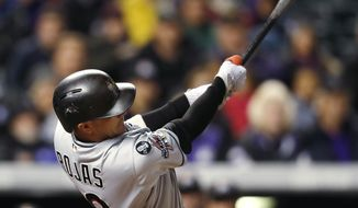 Miami Marlins' Miguel Rojas follows through on an RBI double off Colorado Rockies relief pitcher Kyle Freeland during the sixth inning of a baseball game Monday, Sept. 25, 2017, in Denver. Miami won 5-4. (AP Photo/David Zalubowski)