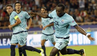 Porto's Vincent Aboubakar reacts after scoring the opening goal during the Champions League Group G first leg soccer match between Monaco and FC Porto at Louis II stadium in Monaco, Tuesday, Sept. 26, 2017. (AP Photo/Claude Paris)