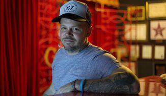 FILE - In this June 16, 2017 photo, file photo, singer-songwriter Rene Perez Joglar, also known as Residente, poses for a photo during an interview in Mexico City. Residente leads Latin Grammys nominations with nine nods that include record, song and album of the year. The Latin Recording Academy announced its nominees Tuesday, Sept. 26. (AP Photo/Eduardo Verdugo, File)