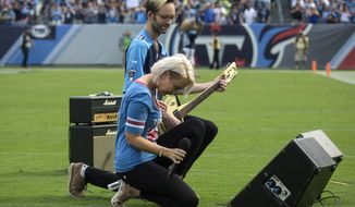 """n this Sunday, Sept. 24, 2017, file photo, Meghan Linsey, a former contestant on """"The Voice,"""" kneels after singing the national anthem before the start of the Tennessee Titans and Seattle Seahawks football game at Nissan Stadium in Nashville, Tenn. (Ryan Hermens/The Paducah Sun via AP, File)"""