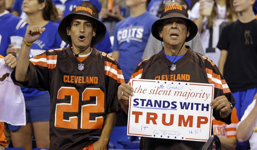 FILE - In this Sunday, Sept. 24, 2017, file photo, Cleveland Browns fans hold a sign following the national anthem before an NFL football game between the Indianapolis Colts and the Cleveland Browns in Indianapolis. What began more than a year ago with a lone NFL quarterback protesting police brutality against minorities by kneeling silently during the national anthem before games has grown into a roar with hundreds of players sitting, kneeling, locking arms or remaining in locker rooms, their reasons for demonstrating as varied as their methods.  (AP Photo/Michael Conroy, File)
