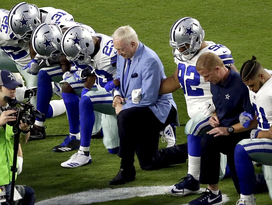 In this Monday, Sept. 25, 2017, file photo, the Dallas Cowboys, led by owner Jerry Jones, center, take a knee prior to the national anthem before an NFL football game against the Arizona Cardinals in Glendale, Ariz. What began more than a year ago with a lone NFL quarterback protesting police brutality against minorities by kneeling silently during the national anthem before games has grown into a roar with hundreds of players sitting, kneeling, locking arms or remaining in locker rooms, their reasons for demonstrating as varied as their methods. (AP Photo/Matt York, File)