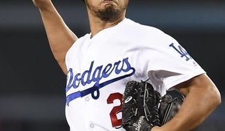 Los Angeles Dodgers starting pitcher Yu Darvish pitches to San Diego Padres' Carlos Asuaje during the first inning of a baseball game in Los Angeles, Monday, Sept. 25, 2017. (AP Photo/Kelvin Kuo)