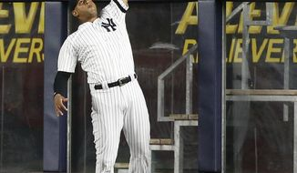New York Yankees center fielder Aaron Hicks, in his first game back off the disabled list, makes a leaping catch of a sacrifice fly by Tampa Bay Rays' Wilson Ramos during the first inning of a baseball game at Yankee Stadium in New York, Tuesday, Sept. 26, 2017. (AP Photo/Kathy Willens)