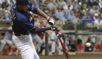Milwaukee Brewers' Domingo Santana hits a three-run home run during the first inning of a baseball game against the Cincinnati Reds Tuesday, Sept. 26, 2017, in Milwaukee. (AP Photo/Morry Gash)