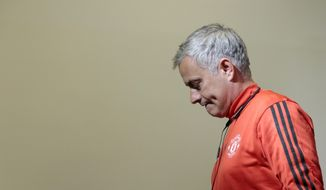 Manchester United manager Jose Mourinho arrives at a news conference ahead of the Champions League soccer match between CSKA Moscow and Manchester United in Moscow, Russia, Tuesday, Sept. 26, 2017. (AP Photo/Ivan Sekretarev)