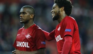Spartak's Luiz Adriano, right smiles besides team mate Fernando after the Champions League soccer match between Spartak Moscow and Liverpool in Moscow, Russia, Tuesday, Sept. 26, 2017. (AP Photo/Alexander Zemlianichenko)