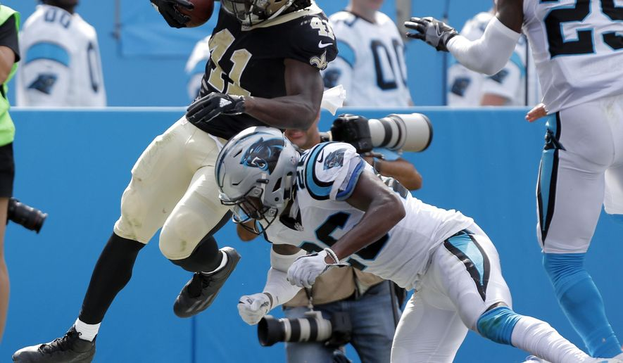 New Orleans Saints' Alvin Kamara (41) runs for a touchdown as Carolina Panthers' Daryl Worley (26) defends in the second half of an NFL football game in Charlotte, N.C., Sunday, Sept. 24, 2017. (AP Photo/Bob Leverone)
