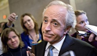 In this Friday, Oct. 11, 2013, file photo, Sen. Bob Corker, R-Tenn., speaks to reporters on Capitol Hill in Washington about the government stalemate. In a surprise announcement, Tuesday, Sept. 26, 2017, the two-term lawmaker says he will not seek re-election in 2018. (AP Photo/J. Scott Applewhite, file)