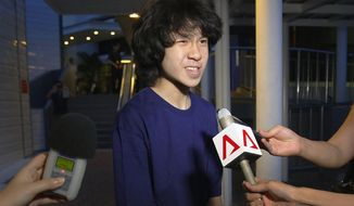 FILE - In this May, 12, 2015, file photo, Singapore teen blogger Amos Yee speaks to reporters in Singapore. A federal immigration appeals court has sided with a Chicago immigration judge's decision to grant asylum to the teenage blogger from Singapore. Attorneys for Amos Yee said Tuesday Sept. 26, 2017, they'd received a Board of Immigration Appeals decision agreeing that the 18-year-old had fear of being persecuted upon return to Singapore.(AP Photo/Wong Maye-E, File)