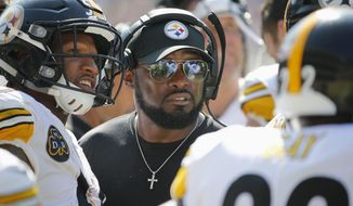 Pittsburgh Steelers head coach Mike Tomlin talks to his players during the second half of an NFL football game against the Chicago Bears, Sunday, Sept. 24, 2017, in Chicago. (AP Photo/Charles Rex Arbogast)