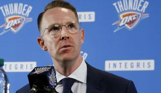 FILE - In this July 12, 2017, file photo, Oklahoma City Thunder general manager Sam Presti answers a question following Paul George's first news conference in Oklahoma City, since the Thunder's blockbuster trade with the Indiana Pacers. The real MVP of the offseason appears to be Presti. The soft-spoken Thunder general manager made blockbuster deals to add Paul George and Carmelo Anthony that immediately put the Thunder in contention to compete with Golden State in the Western Conference.  (AP Photo/Sue Ogrocki, File)