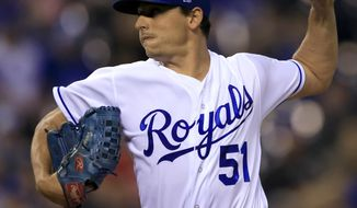 Kansas City Royals starting pitcher Jason Vargas delivers to a Detroit Tigers batter during the first inning of a baseball game at Kauffman Stadium in Kansas City, Mo., Tuesday, Sept. 26, 2017. (AP Photo/Orlin Wagner)