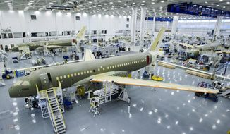 FILE- In this Dec. 18, 2015, file photo, Bombardier's CS100 assembly line is seen at the company's plant in Mirabel, Quebec, Canada. The U.S Commerce Department slapped duties of nearly 220 percent on Canada's Bombardier C Series aircraft Tuesday, Sept. 26, 2017, in a victory for Boeing that is likely to raise tensions between the United States and its allies Canada and Britain. (Ryan Remiorz/The Canadian Press via AP)