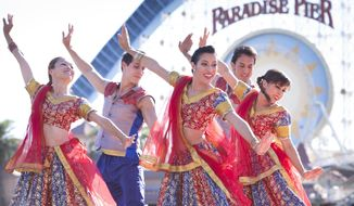 This Nov. 13, 2016 photo shows performers in a Diwali celebration at Disney California Adventure Park in Anaheim, Calif. Diwali is a festival of lights celebrated by Hindus, Sikhs and Jains in India and other countries, but the holiday is becoming better known in the U.S. with more public celebrations here. The Diwali celebration at Disneyland Resort, which includes performances of traditional Indian dances and a Bollywood dance party for guests, is part of a festival of holidays at the theme park reflecting cultural traditions from around the world. The Disney festival begins Nov. 10 this year and runs through Jan. 7. (Scott Brinegar/Disneyland Resort via AP)