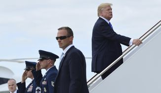 President Donald Trump up the steps of Air Force One at Andrews Air Force Base in Md., Tuesday, Sept. 26, 2017, where he is heading to New York. Trump will meet with major GOP donors for a private dinner in New York as part of a fundraising effort for the Republican National Committee. (AP Photo/Susan Walsh)