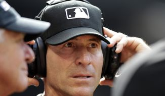 This April 9, 2017, photo shows MLB umpire Angel Hernandez in the first inning of a baseball game between the Arizona Diamondbacks and the Cleveland Indians in Phoenix. (AP Photo/Rick Scuteri) **FILE**