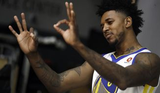 FILE - In this Friday, Sept. 22, 2017, file photo, Golden State Warriors' Nick Young gestures during the NBA basketball team's media day in Oakland , Calif. When Young passed up a couple of shots, he heard about it, from teammate Andre Iguodala and coach Steve Kerr. The Warriors want the guard to do his thing and shoot, and young hopes to help his new team win another title, even as a role player. (AP Photo/Marcio Jose Sanchez, File)