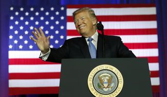 President Donald Trump waves before speaking about tax reform at the Farm Bureau Building at the Indiana State Fairgrounds, Wednesday, Sept. 27, 2017, in Indianapolis. (AP Photo/Alex Brandon)