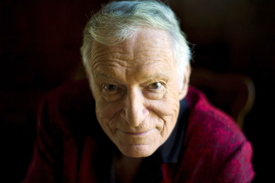 This Oct. 13, 2011, file photo shows  American magazine publisher, founder and Chief Creative Officer of Playboy Enterprises Hugh Hefner at his home at the Playboy Mansion in Beverly Hills, Calif. (AP Photo/Kristian Dowling) ** FILE **