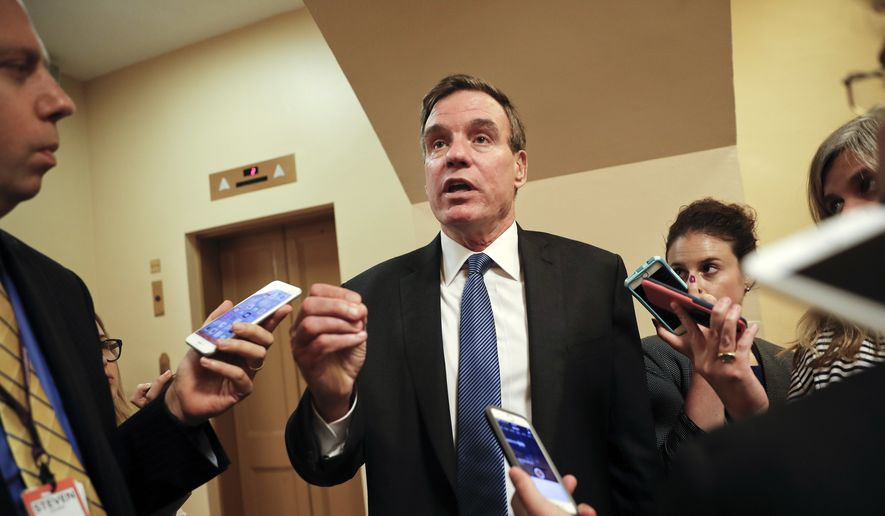 Senate Intelligence Committee Vice Chairman Sen. Mark Warner, D-Va., speaks with reporters on Capitol Hill in Washington, Wednesday, Sept. 27, 2017. (AP Photo/Pablo Martinez Monsivais)