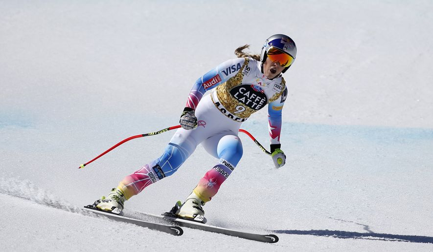 FILE - In this file photo dated Wednesday, March 15, 2017, United States competitor Lindsey Vonn finishes a run at the women's World Cup downhill ski race in Aspen, Colo.  Vonn Wednesday Sept. 27, 2017, has requested to race against men in a mixed gender World Cup downhill event and the request will be considered by the International Ski Federation (FIS) next week. (AP Photo/Brennan Linsley, FILE)
