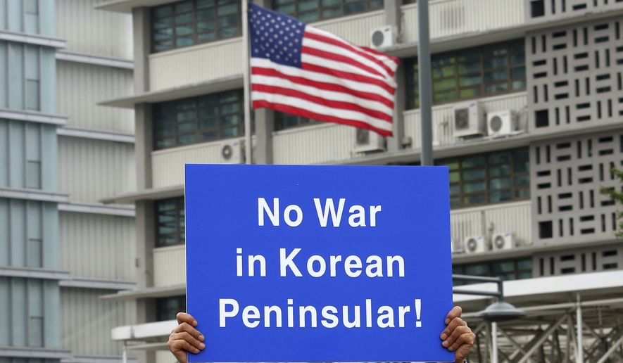 "A South Korean protester holds up a card during a rally to denounce the United States' policy against North Korea in front of U.S. Embassy in Seoul, South Korea, Wednesday, Sept. 27, 2017. North Korea's top diplomat said Monday that a weekend tweet by U.S. President Donald Trump was a ""declaration of war"" and North Korea has the right to retaliate by shooting down U.S. bombers, even in international airspace. (AP Photo/Ahn Young-joon)"