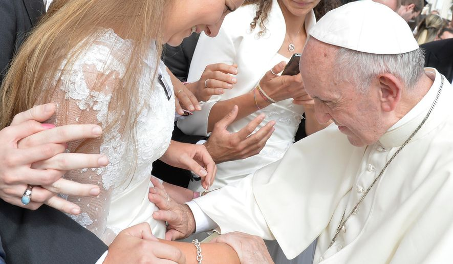 Pope Francis blesses a pregnant woman during his weekly general audience, at the Vatican, Wednesday, Sept. 27, 2017.  (L'Osservatore Romano/Pool via AP)